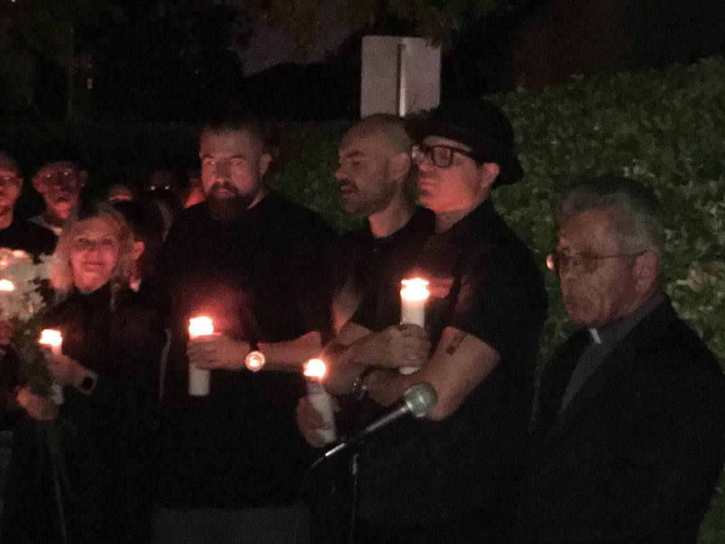 Zak Bagans,in glasses, and Father Dave Casaleggio are among the mourners shown during candlelight vigil for honoring those killed and injured at Route 91 Harvest shooting. The event was held at Za ...