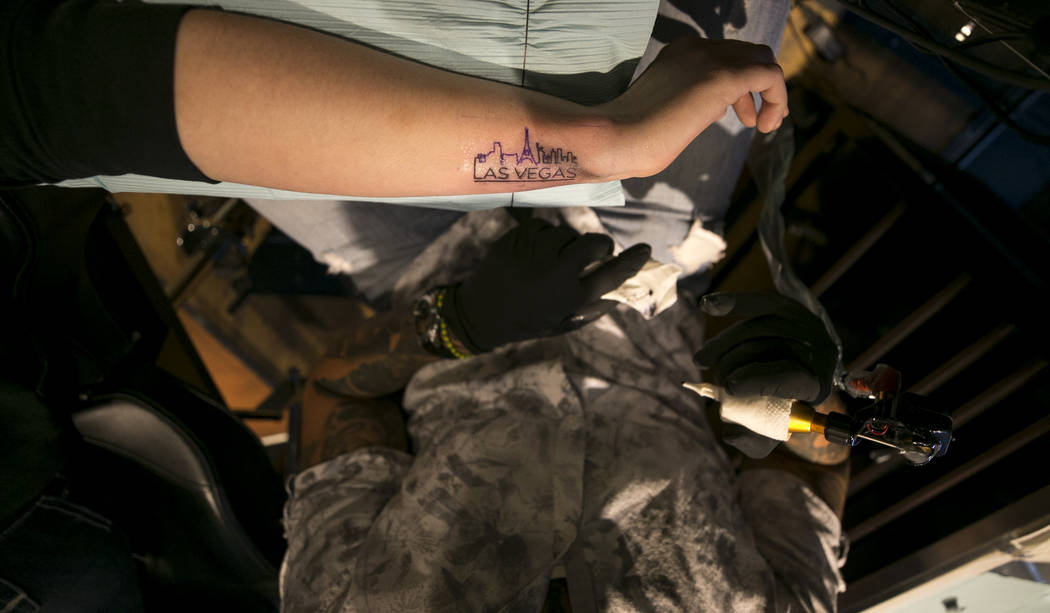 ICU nurse Devin Danner, 25, of Conway, Arkansas get a  Las Vegas memorial tattoo from artist Jose Carlos Del Campo at Club Tattoo inside Planet Hollywood, Thursday, Oct. 5, 2017, in Las Vegas. Ric ...