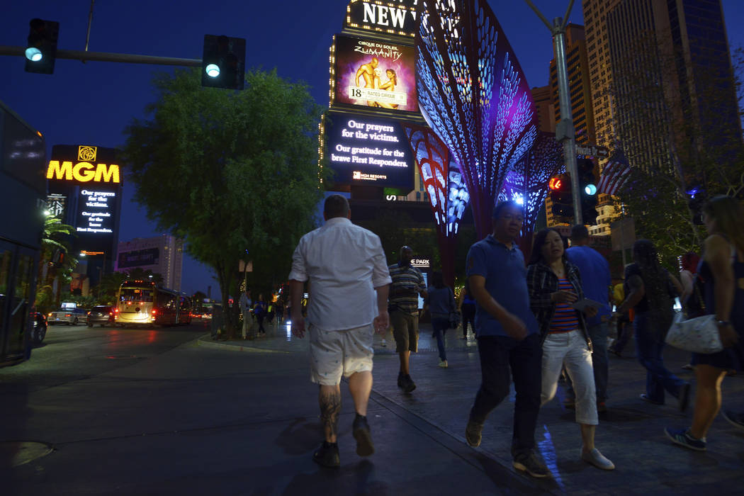 Marquees along the Las Vegas Strip pay respect to the victims and first responders of the previous Sunday's mass shooting. (Sam Morris/Las Vegas News Bureau)