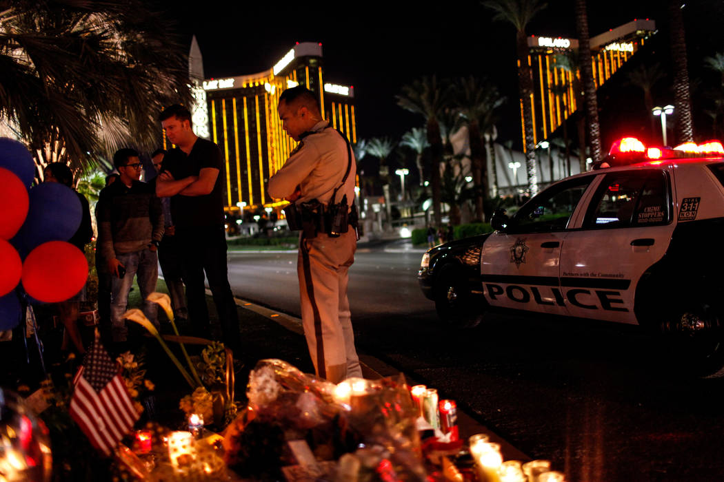Las Vegas Metro Police Sgt. Charles Jivapong stops by a vigil in remembrance of the mass shooting victims along The Strip nearby Mandalay Bay in Las Vegas, Thursday, Oct. 5, 2017. Joel Angel Juare ...