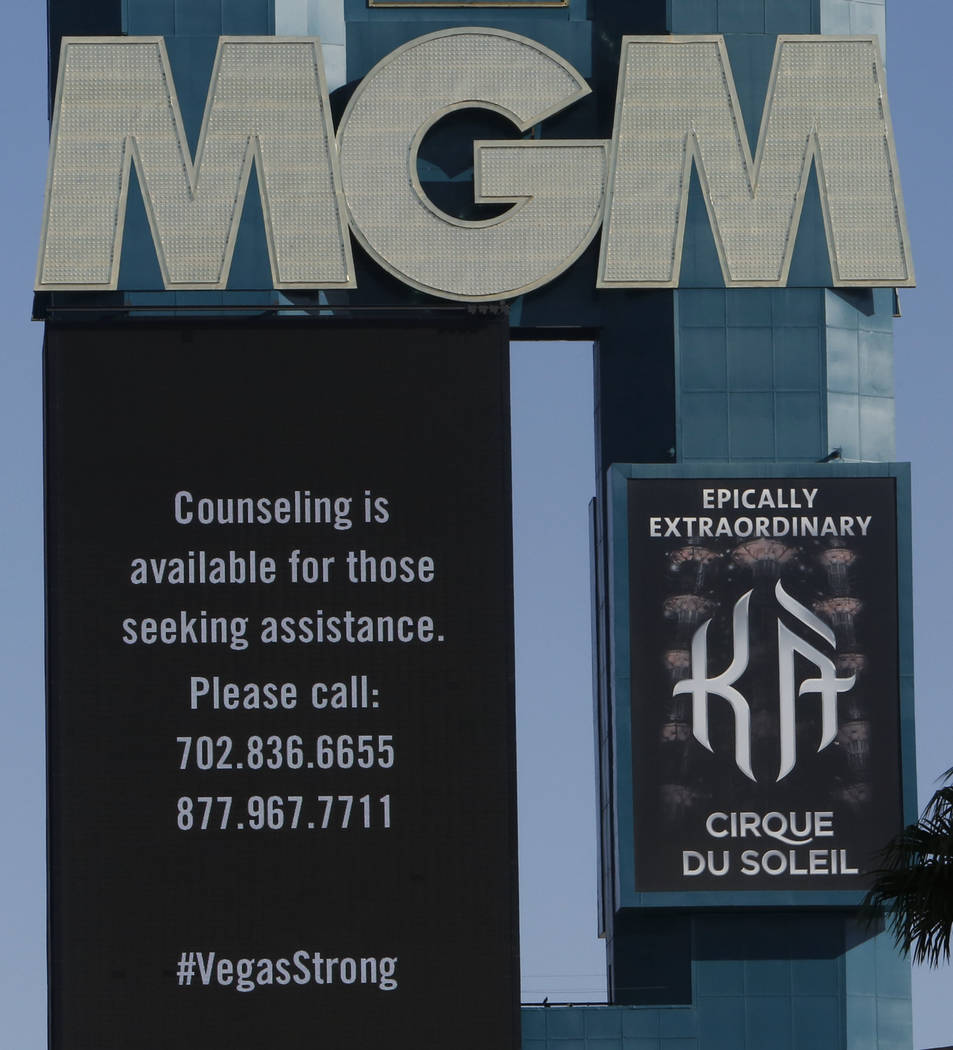 The marquee at MGM Resorts International displays phone numbers for those seeking counseling to call in the aftermath of last Sunday night's mass shooting on Thursday, Oct. 5, 2017, in Las Vegas.  ...