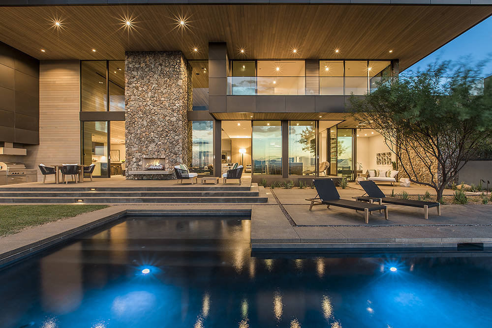 The two-story, 7,555-square-foot home has two wings joined by a double-ceiling-height open great room that teases visitors with a preview of the horizon, visible through glass doors leading to the ...