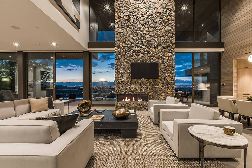 The living room features Strip views.  (Ascaya)