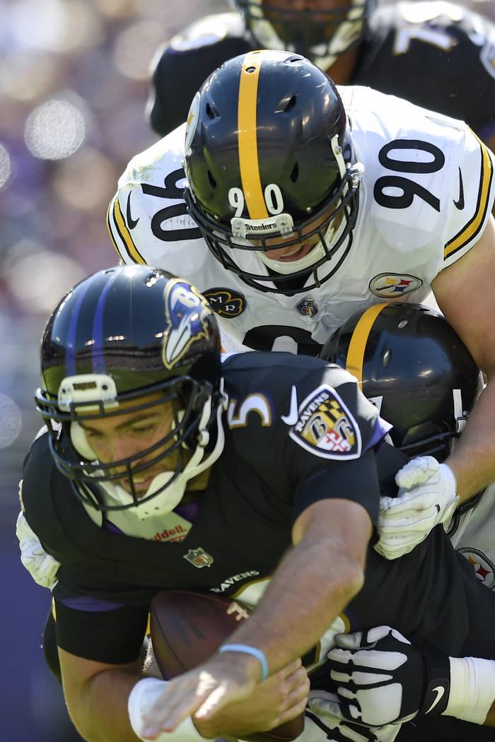 fda5e4340dd Baltimore Ravens quarterback Joe Flacco (5) is sacked by Pittsburgh Steelers  outside linebacker T.J.