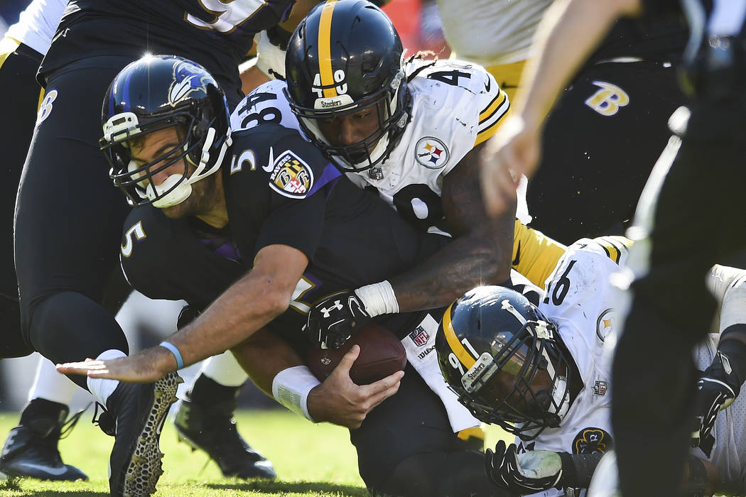 64bee65824c Baltimore Ravens quarterback Joe Flacco (5) is sacked by Pittsburgh Steelers  outside linebacker Bud