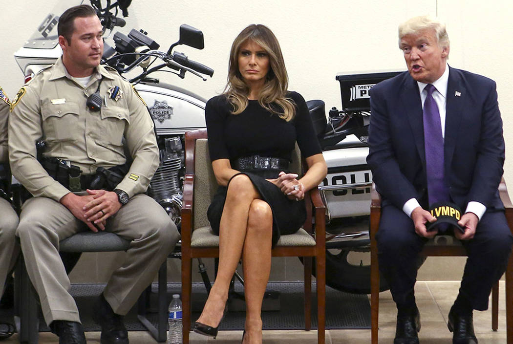 President Donald Trump and first lady Melania Trump meet with Metro officer Casey Clarkson, left, and other first responders at Metropolitan Police Department headquarters in Las Vegas on Wednesda ...