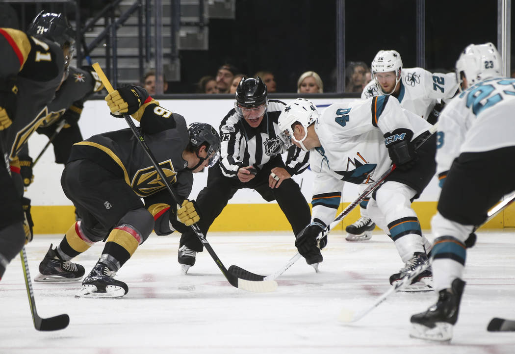 Golden Knights and San Jose Sharks players face-off during the second period of an NHL preseason hockey game at T-Mobile Arena in Las Vegas on Sunday, Oct. 1, 2017. Chase Stevens Las Vegas Review- ...