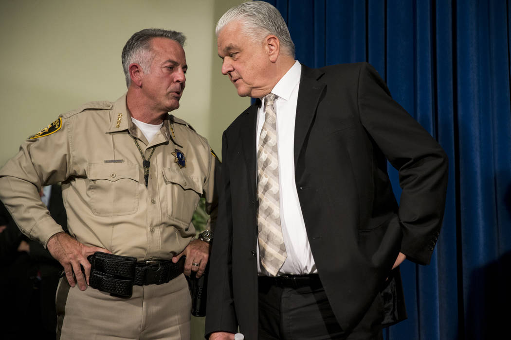 Clark County's Sheriff Joe Lombardo, left, and Commissioner Steve Sisolak during a press conference on the mass shooting, at the Las Vegas Metropolitan Police Department headquarters in Las Vegas, ...