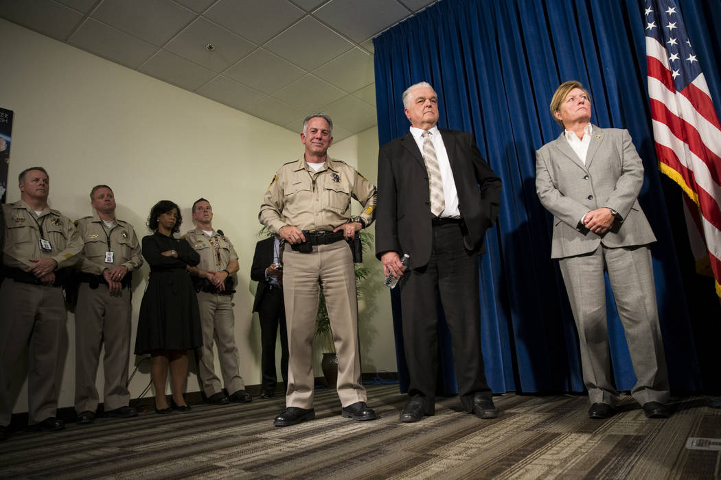 Clark County's Sheriff Joe Lombardo, left, and Commissioner Steve Sisolak, center, during a press conference on the mass shooting, at the Las Vegas Metropolitan Police Department headquarters in L ...