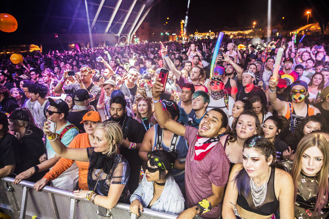 Fans of Pretty Lights cheer during the EDM bands performance on the Fremont Stage during the final day of the Life is Beautiful music and arts festival on Sunday, September 24, 2017, in Las Vegas. ...