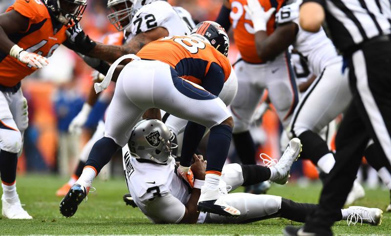 Oct 1, 2017; Denver, CO, USA; Denver Broncos outside linebacker Von Miller (58) sacks Oakland Raiders quarterback EJ Manuel (3) in the third quarter at Sports Authority Field at Mile High. Mandato ...