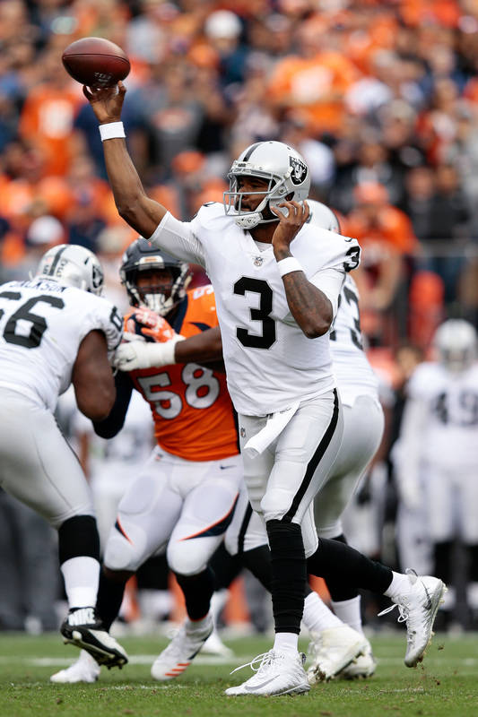 Oct 1, 2017; Denver, CO, USA; Oakland Raiders quarterback EJ Manuel (3) attempts a pass in the third quarter against the Denver Broncos at Sports Authority Field at Mile High. Mandatory Credit: Is ...