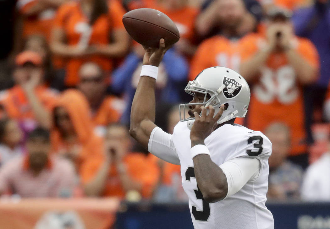 Oakland Raiders quarterback EJ Manuel passes against the Denver Broncos during the second half of an NFL football game Sunday, Oct. 1, 2017, in Denver. (AP Photo/Jack Dempsey)