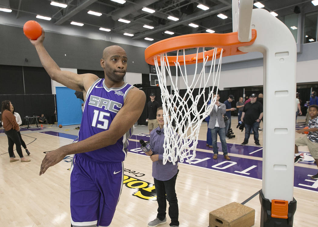 Sacramento Kings guard Vince Carter, a former Slam Dunk Contest champion, demonstrates his dunking ability on plastic youth basketball hoop at the NBA basketball team's media day, Monday, Sept. 25 ...