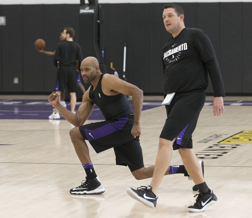 Sacramento Kings guard Vince Carter reacts during a passing drill against assistant coach Jason March, right, during the Kings basketball training camp, Wednesday, Sept. 27, 2017, in Sacramento, C ...