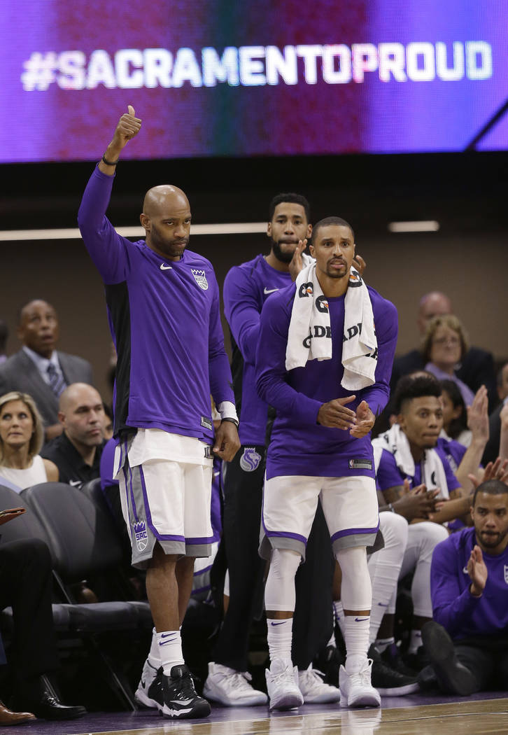 Sacramento Kings' Vince Carter, left, Garrett Temple, center, and George Hill, right, celebrate after the Kings scored during the second half of an NBA preseason basketball game against the San An ...