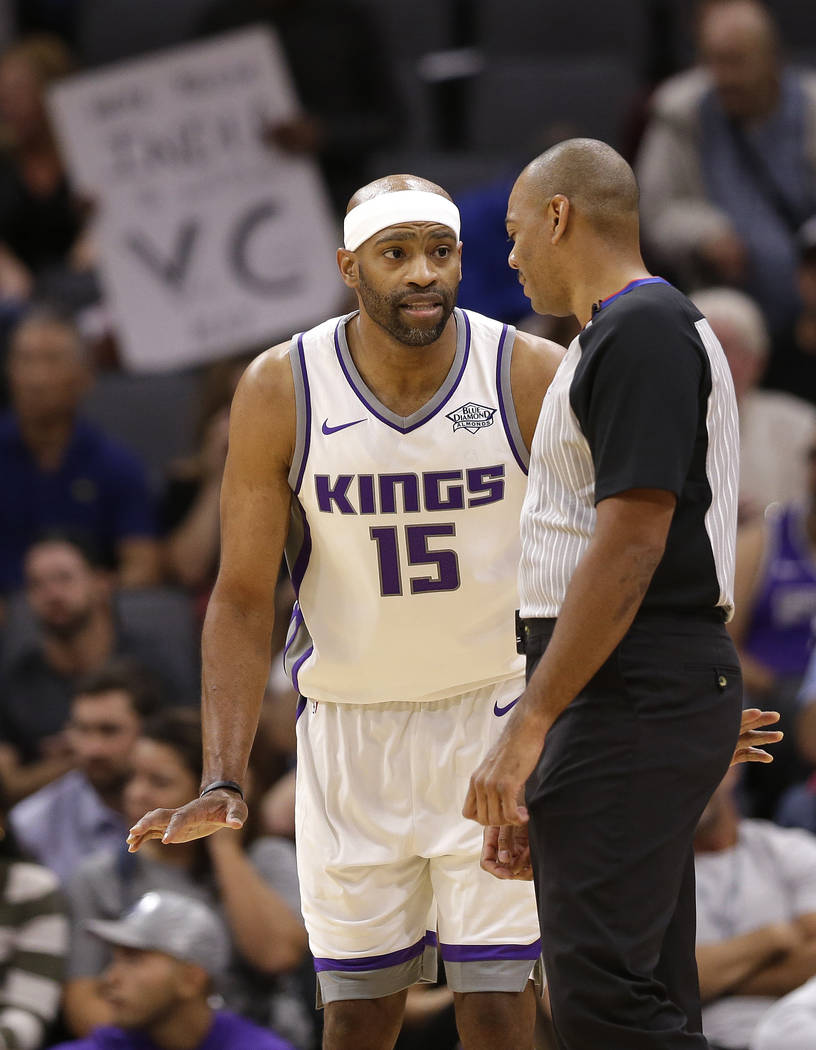 Sacramento Kings guard Vince Carter talks with referee Karl Lane during the first quarter of an NBA preseason basketball game against the San Antonio Spurs Monday, Oct. 2, 2017, in Sacramento, Cal ...