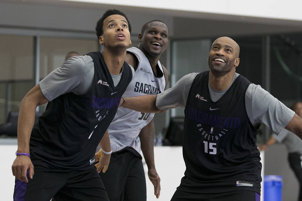 Sacramento Kings' Skal Labissiere, left, Zach Randolph, center, and Vince Carter position themselves for a rebound during the NBA basketball team's training camp Thursday, Sept. 28, 2017, in Sacra ...