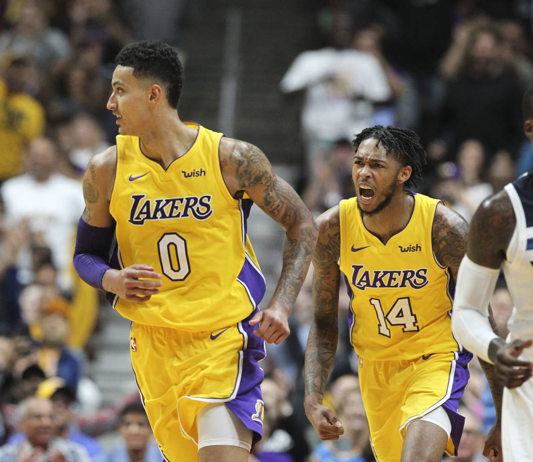 Los Angeles Lakers forward Kyle Kuzma #0 and forward Brandon Ingram #14 in actions during an NBA preseason basketball game between Los Angeles Lakers and Minnesota Timberwolves in Anaheim, Calif., ...