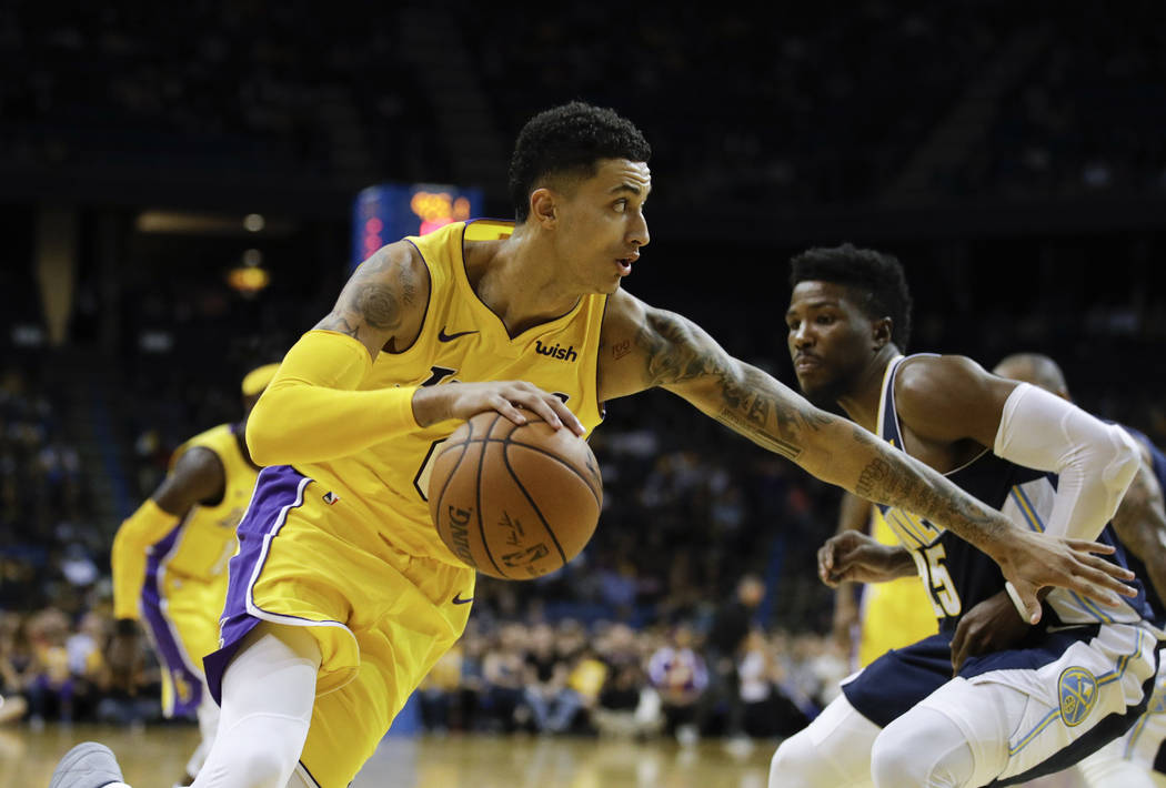 Los Angeles Lakers' Kyle Kuzma drives toward the basket during the second half of an NBA preseason basketball game against the Denver Nuggets, Wednesday, Oct. 4, 2017, in Ontario, Calif. (AP Photo ...