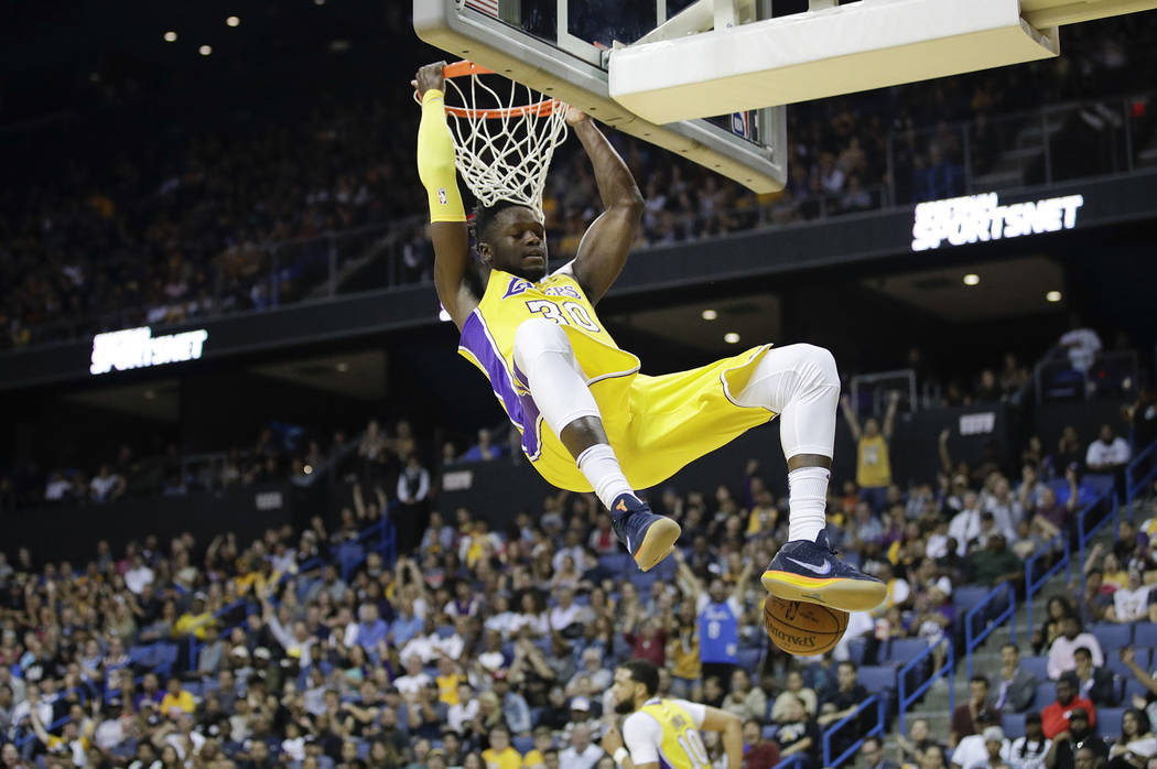 Los Angeles Lakers' Julius Randle descends after making a dunk during the second half of an NBA preseason basketball game against the Denver Nuggets, Wednesday, Oct. 4, 2017, in Ontario, Calif. (A ...