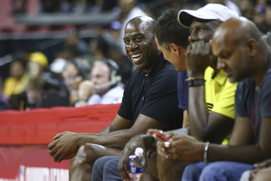 Los Angeles Lakers' Magic Johnson watches the action against the Los Angeles Clippers during a basketball game at the NBA Summer League at the Thomas & Mack Center in Las Vegas on Friday, July ...