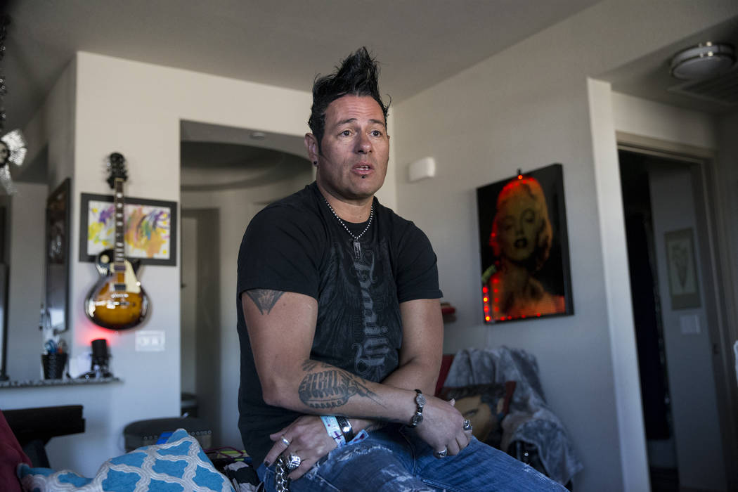 Bryan Hopkins, member of the band Elvis Monroe, and who attended Route 91 festival during the mass shooting last Sunday, share his story at his home in Las Vegas, Thursday, Oct. 5, 2017. Erik Verd ...