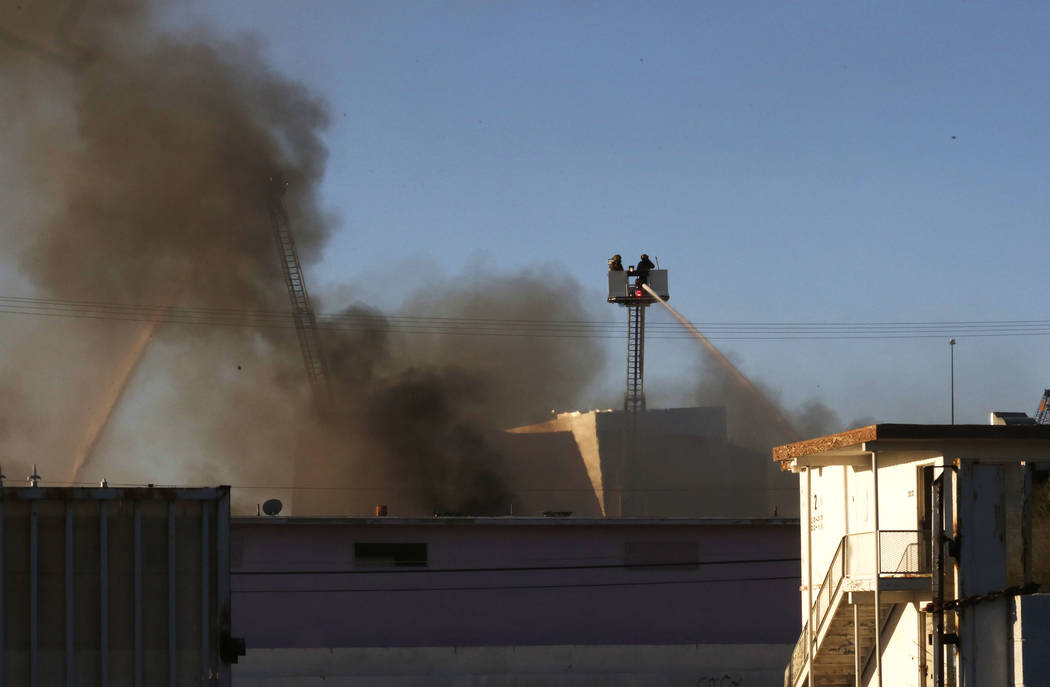 North Las Vegas firefighters battle a two-alarm blaze at 900 W. Bonanza Road, the old site of the Moulin Rouge, near downtown on Thursday, Oct. 5, 2017, in Las Vegas. Bizuayehu Tesfaye Las Vegas R ...