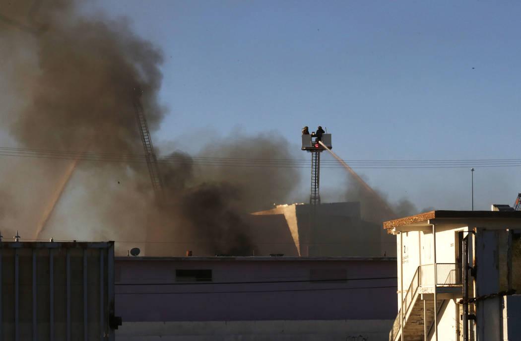 North Las Vegas firefighters battle a two-alarm blaze at 900 W. Bonanza Road, the old site of the Moulin Rouge, near downtown on Thursday, Oct. 5, 2017, in Las Vegas. Bizuayehu Tesfaye Las Vegas R ...