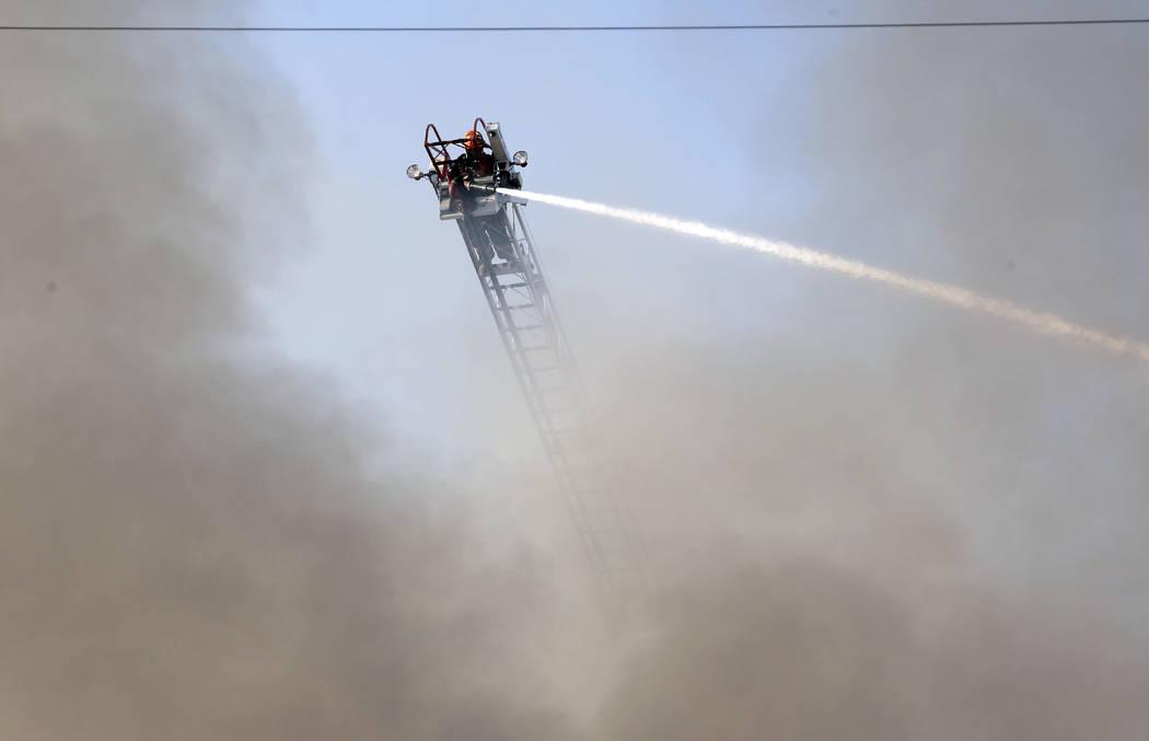 A North Las Vegas firefighter battles a two-alarm blaze at 900 W. Bonanza Road, the old site of the Moulin Rouge, near downtown on Thursday, Oct. 5, 2017, in Las Vegas. Bizuayehu Tesfaye Las Vegas ...