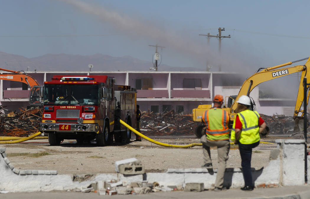 Firefighters and demolition crews work the scene after a fire gutted the historic Moulin Rouge in Las Vegas on Thursday, Oct. 5, 2017. Chase Stevens Las Vegas Review-Journal @csstevensphoto