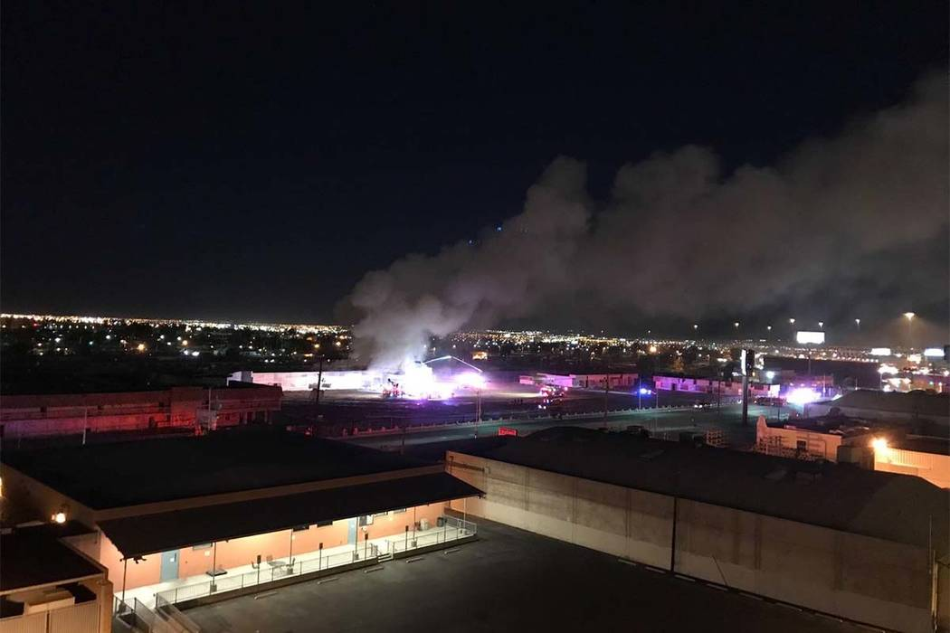 A fire at a vacant apartment building on the old site of the Moulin Rouge at 900 W. Bonanza Road can be seen from the roof of the Las Vegas Review-Journal early Thursday, Oct. 5, 2017. (Tomas Torr ...