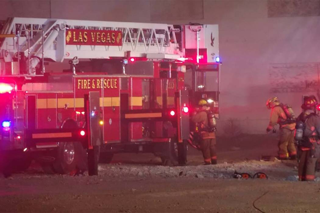 Las Vegas firefighters are battling a two-alarm blaze at vacant apartments at 900 W. Bonanza Road where the Moulin Rouge used to be located. (Max MIchor/Las Vegas Review-Journal)