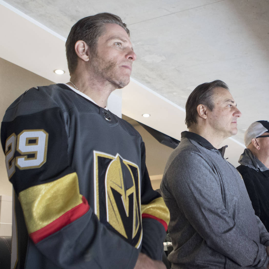 The minority owners of the Vegas Golden Knights, Joe Maloof, left, and Gavin Maloof, watch the team's opening ceremony at the season home opener at the T-Mobile Arena in Las Vegas, Tuesday, Oct. 1 ...