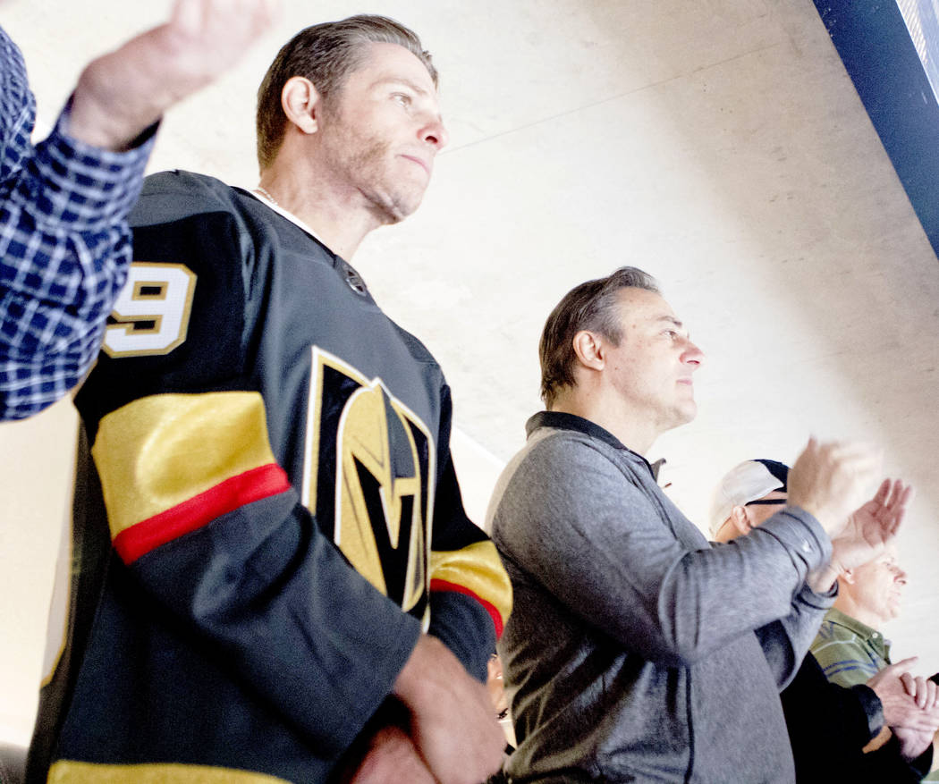 The minority owners of the Vegas Golden Knights, Joe Maloof, left, and Gavin Maloof, watch the team's opening ceremonies at the season home opener at the T-Mobile Arena in Las Vegas, Tuesday, Oct. ...