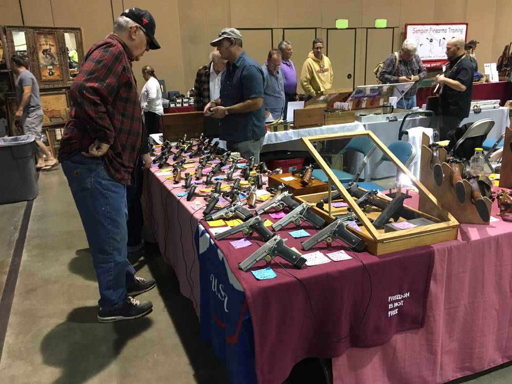 A potential customer looks over the merchandise at one booth at the Crossroads of the West Gun Show held in Reno on Saturday, Oct. 7, 2017. Sean Whaley Las Vegas Review-Journal