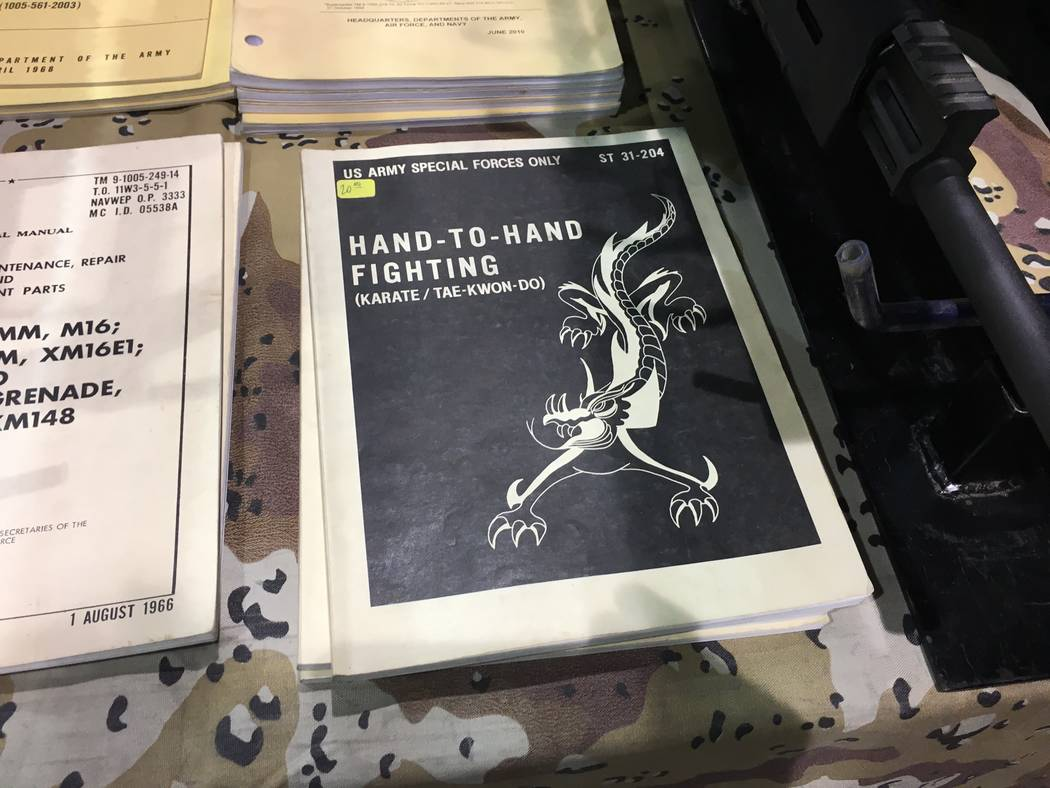 In addition to handguns and rifles, other items for sale included this U.S. Special Forces hand to hand combat manual at the Crossroads of the West Gun Show held in Reno on Saturday, Oct. 7, 2017. ...