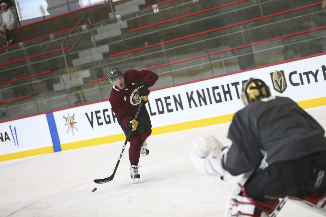 Vegas Golden Knights left wing David Perron (57) takes a shot on Knights goalie Marc-Andre Fleury (29) in a drill during the NHL team's practice at the City National Arena in Las Vegas, Wednesday, ...