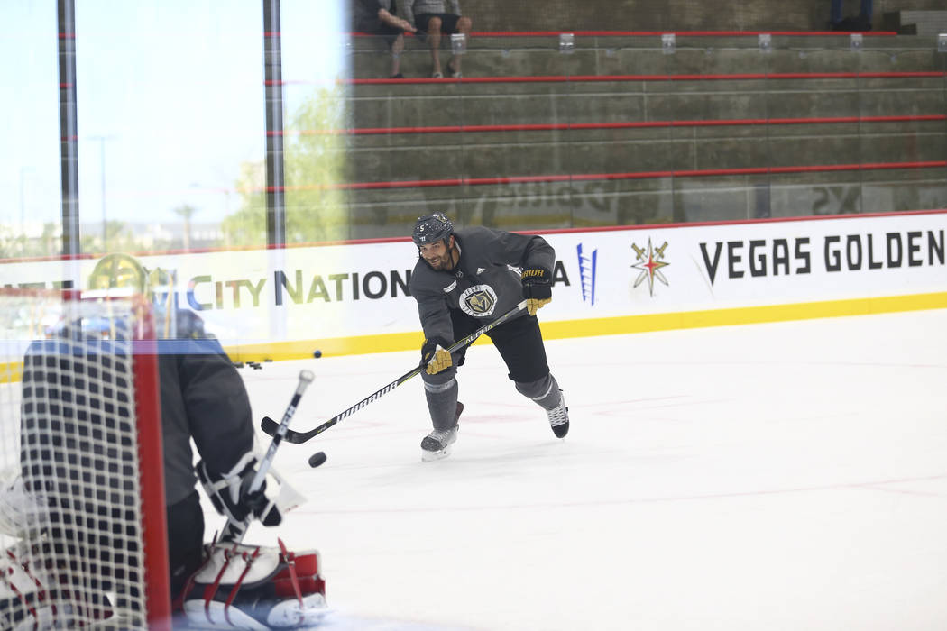 Vegas Golden Knights defenseman Deryk Engelland (5) shoots on Knights goalie Marc-Andre Fleury (29) in a drill during the NHL team's practice at the City National Arena in Las Vegas, Wednesday, Oc ...