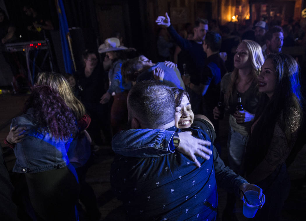 Attendees greet each other with hugs during a benefit show for the victims of the Route 91 shooting at Stoney's Rockin' Country on Wednesday, October 4, 2017, in Las Vegas. (Benjamin Hager/Las Veg ...