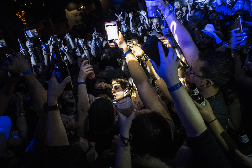 A packed dance hall celebrates after having a mass hug during a benefit show for the victims of the Route 91 shooting at Stoney's Rockin' Country on Wednesday, October 4, 2017, in Las Vegas. (Benj ...