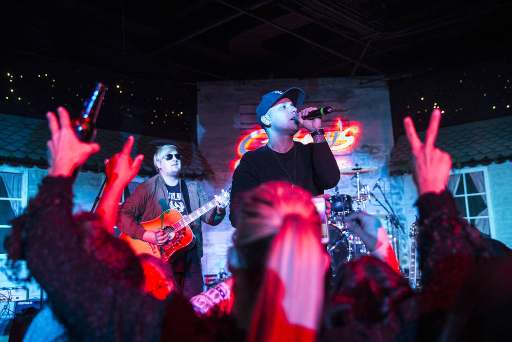 Carter Winter, middle, performers during a benefit show for the victims of the Route 91 shooting at Stoney's Rockin' Country on Wednesday, October 4, 2017, in Las Vegas. (Benjamin Hager/Las Vegas  ...