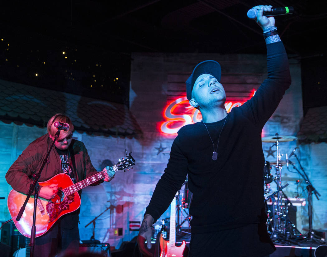Carter Winter, right, performers during a benefit show for the victims of the Route 91 shooting at Stoney's Rockin' Country on Wednesday, October 4, 2017, in Las Vegas. (Benjamin Hager/Las Vegas R ...