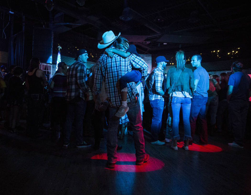 Bryan Turner, middle, holds his daughter Cienna during a benefit show for the victims of the Route 91 shooting at Stoney's Rockin' Country on Wednesday, October 4, 2017, in Las Vegas. (Benjamin Ha ...