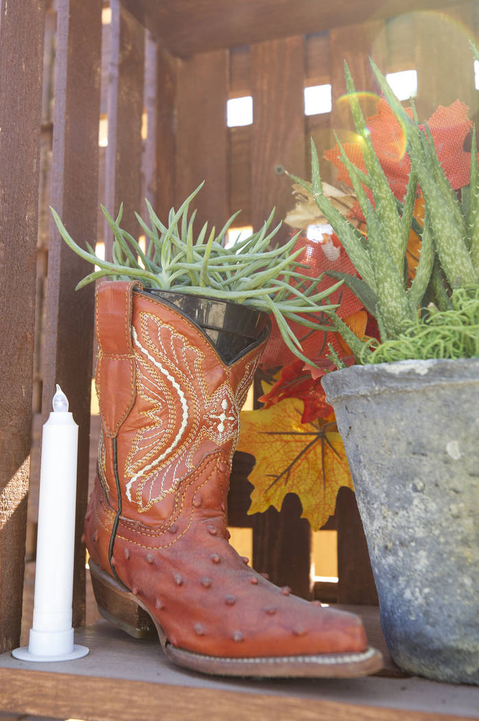 Cowboy boots hang on the prayer wall at an under-construction community healing garden located at South Casino Center and East Charleston boulevards in downtown Las Vegas, Thursday, Oct. 5, 2017.  ...