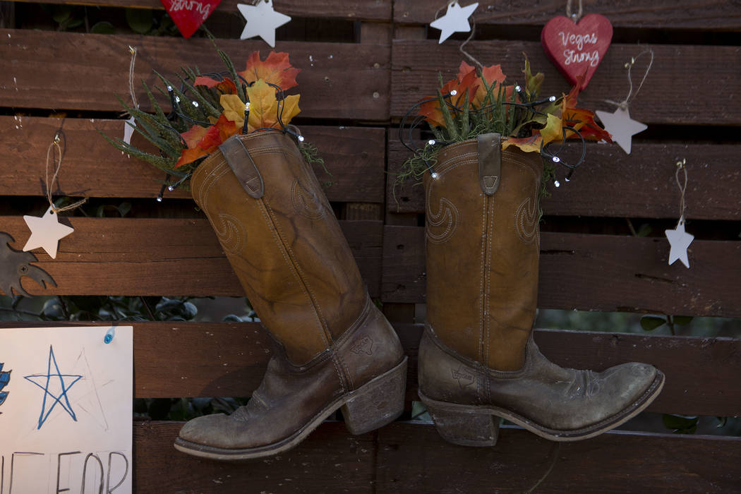 """Boots hang on the """"Remembrance Wall"""" at the Community Healing Garden in Las Vegas, Friday, Oct. 6, 2017. The city of Las Vegas dedicated the new healing garden to victims of Sund ..."""