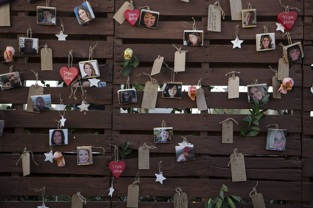 """Pictures of victims hang on the """"Remembrance Wall"""" at the Community Healing Garden in Las Vegas, Friday, Oct. 6, 2017. The city of Las Vegas dedicated the new healing garden to v ..."""