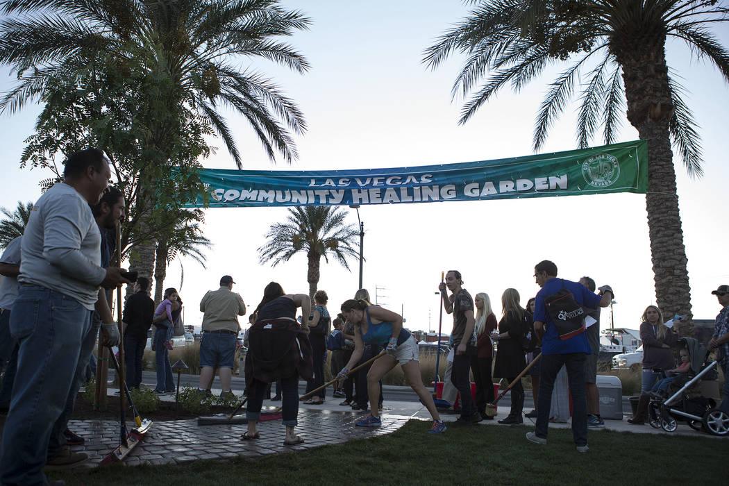 People prepare the Community Healing Garden in Las Vegas, Friday, Oct. 6, 2017. The city of Las Vegas dedicated the new healing garden to victims of Sunday's shooting. Bridget Bennett Las Vegas Re ...