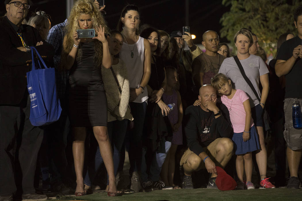 Attendees gather as people speak about city of Las Vegas employee and Saturday shooting victim Cameron Robinson at the Community Healing Garden in Las Vegas, Friday, Oct. 6, 2017. The city of Las  ...
