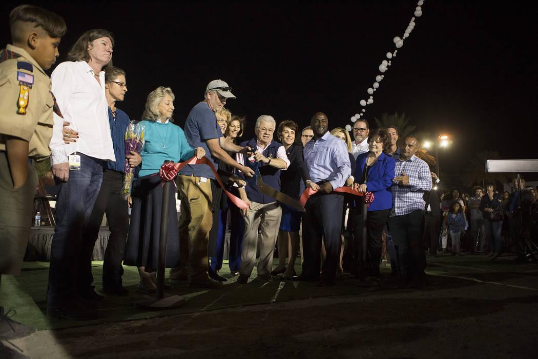 The ribbon is cut for the Community Healing Garden in Las Vegas, Friday, Oct. 6, 2017. The city of Las Vegas dedicated the new healing garden to victims of Sunday's shooting. Bridget Bennett Las V ...